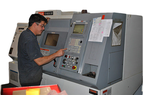 CNC Machinist working on Mazak Nexus 250 CNC Lathe at Silverado Oil Tools